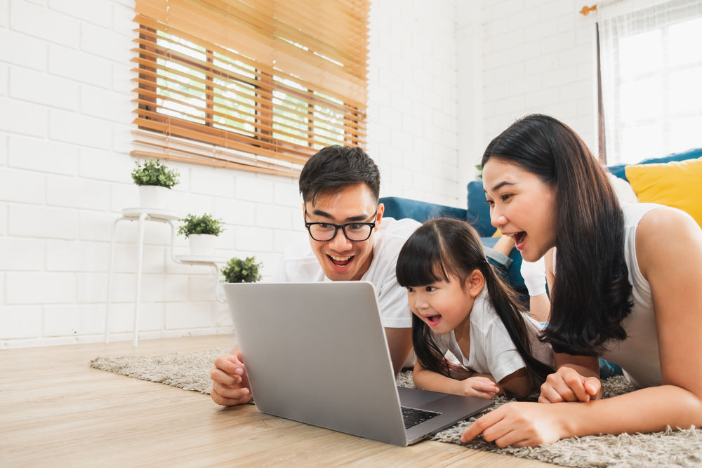 family using laptop (virtual tour)